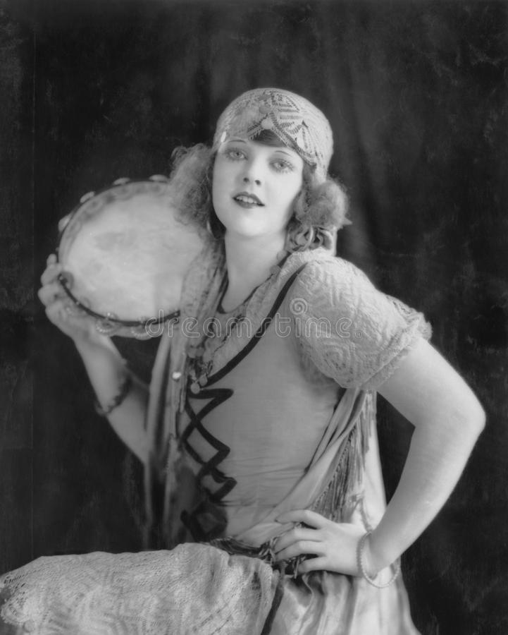 Portrait of woman with tambourine. (All persons depicted are no longer living and no estate exists. Supplier grants that there will be no model release issues royalty free stock photography