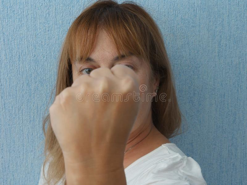 Woman with clenched fist royalty free stock photography
