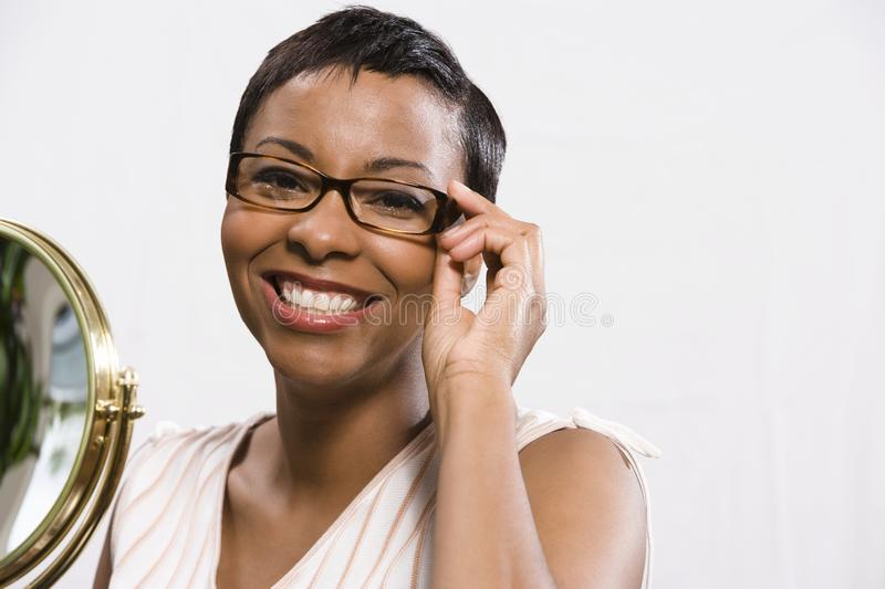 Portrait Of Woman Trying On Glasses royalty free stock images