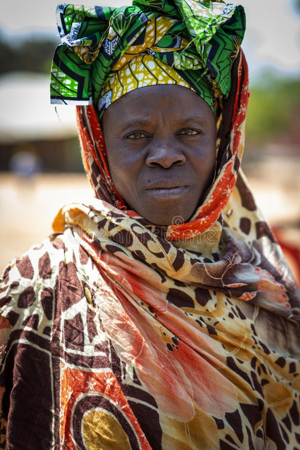 Portrait of a woman in the village of Mandina Mandinga in the Gabu Region. Gabu Region, Republic of Guinea-Bissau - February 7, 2018: Portrait of a woman in the stock photos
