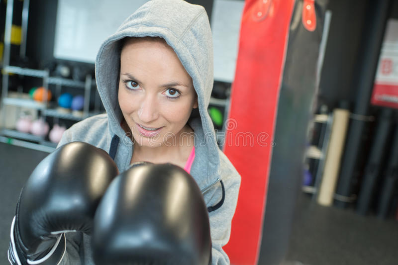 Portrait woman wearing boxing gloves stock image