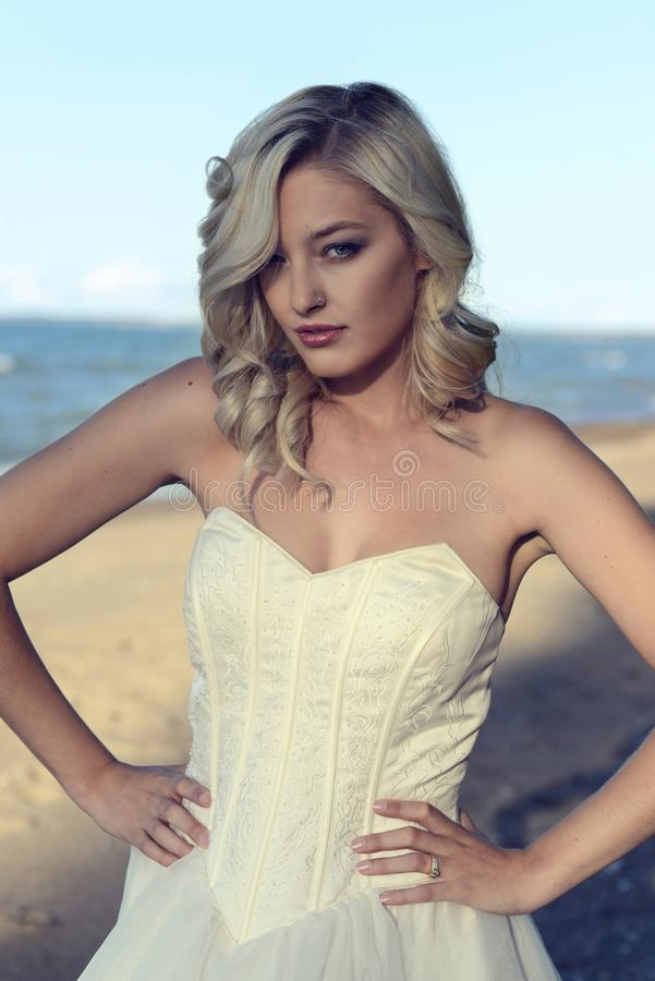 Portrait of woman wearing corset dress at the beach stock photos