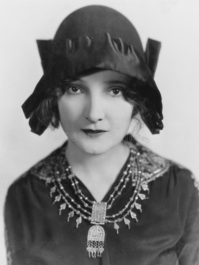 Portrait of woman wearing hat and necklace stock photos