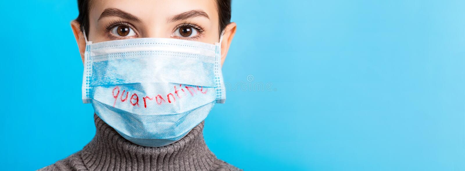 Portrait of a woman wearing medical mask with China quarantine word at blue background. Coronavirus and healthcare concept banner.  royalty free stock photography