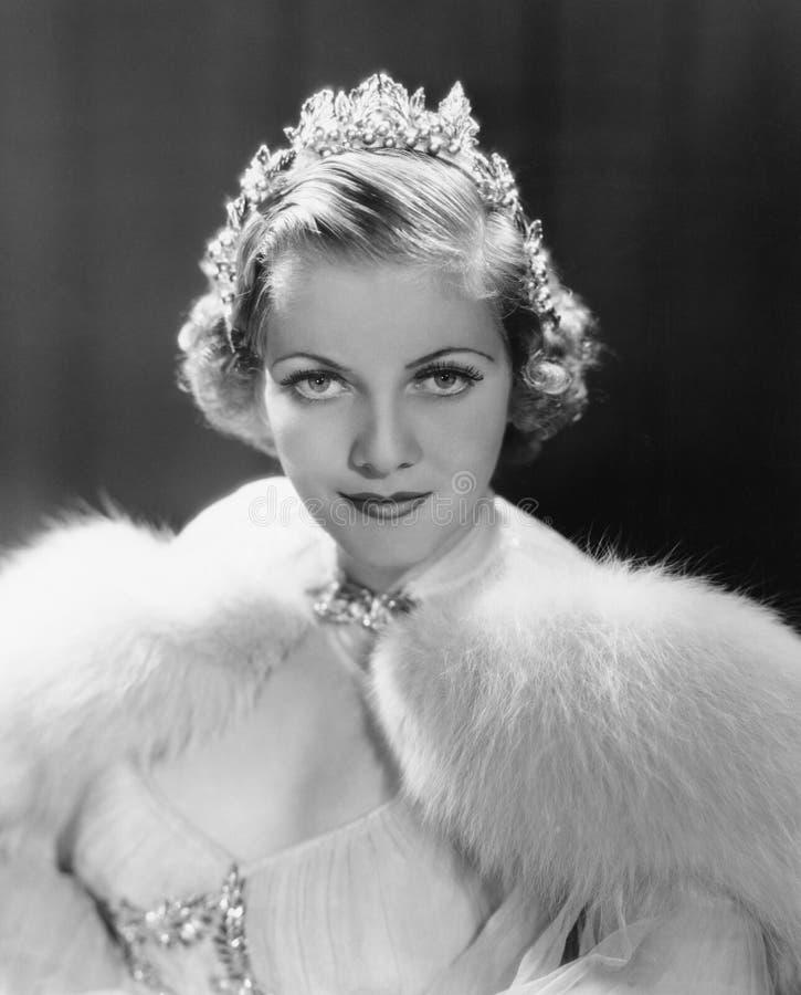 Portrait of woman wearing tiara stock images