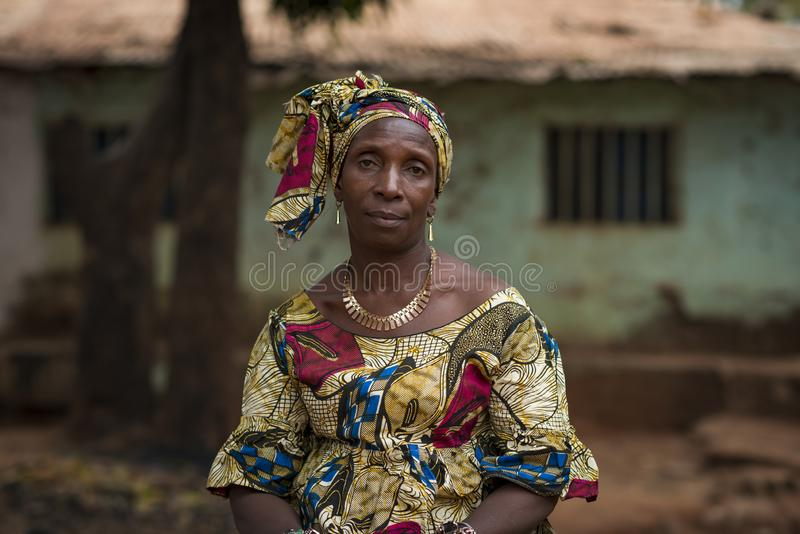 Portrait of a woman wearing a traditional dress with veil, at the Missira neighborhood in the city of Bissau, Guinea Bissau. Bissau, Republic of Guinea-Bissau royalty free stock image