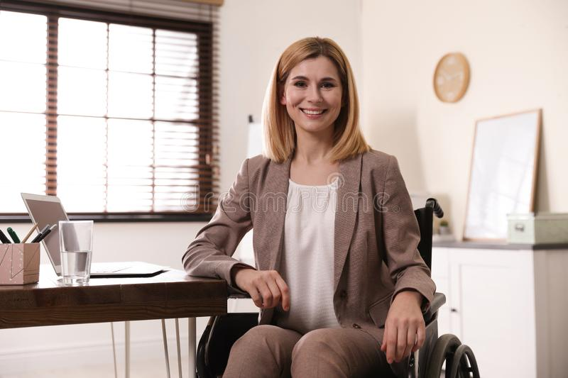 Portrait of woman in wheelchair royalty free stock photo