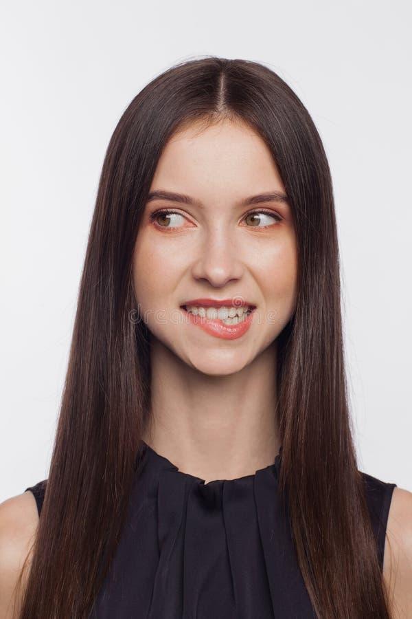 Portrait of a woman who bite his lips. Portrait of a beautiful young woman who bite his lips stock image