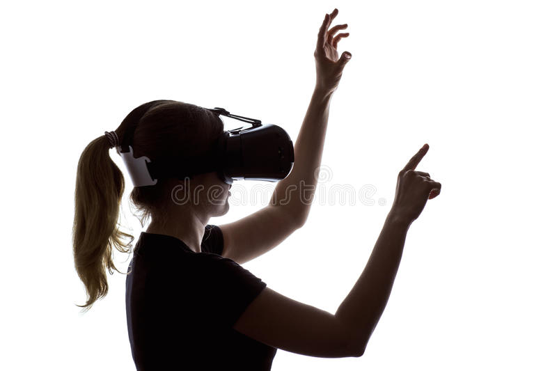Portrait of a woman working in three-dimensional space in virtual reality. Silhouette portrait of a young woman working in three-dimensional space in virtual stock images