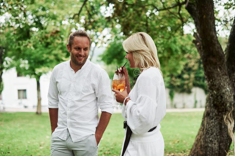 Portrait of women and men in white clothes spending good time with lovely mood royalty free stock images