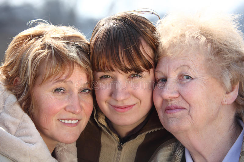 Portrait of women of three generations. Of one family, faces royalty free stock photo