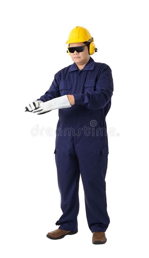 Portrait of a worker in Mechanic Jumpsuit is Removing gloves iso stock photo