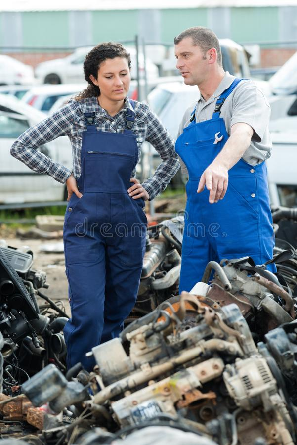 Portrait workers on junkyard stock photography