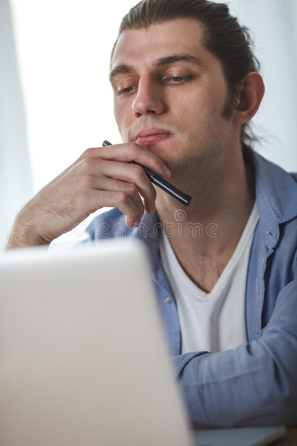 Portrait of working man at his home stock photography