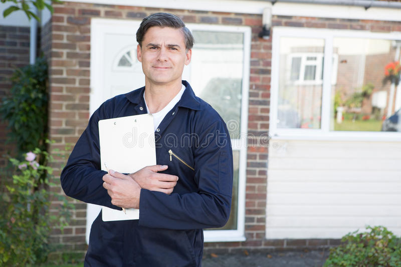 Portrait Of Workman Preparing Estimate For Work On House royalty free stock photo
