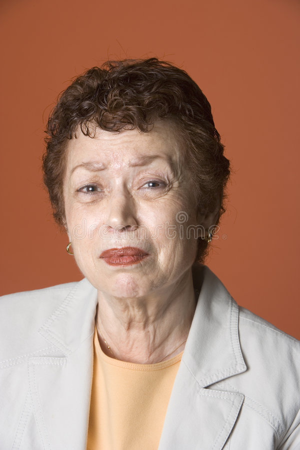 Portrait of worried Latino woman stock images