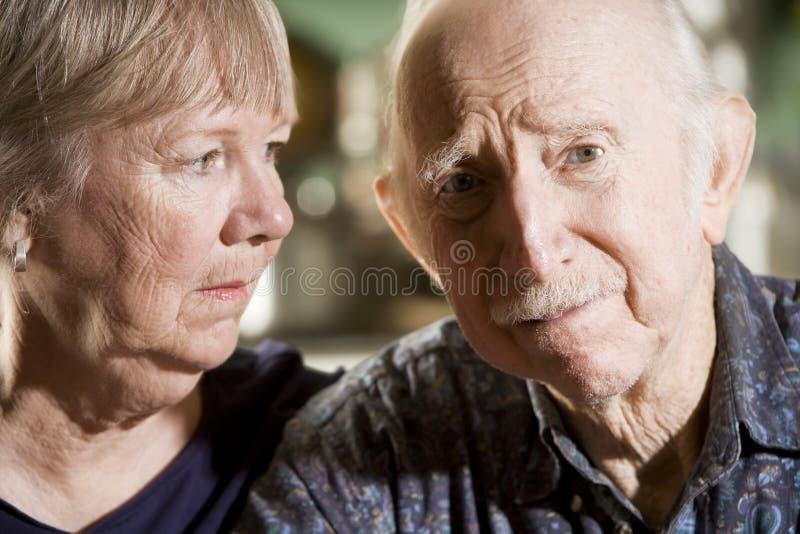 Portrait of Worried Senior Couple. Close Up Portrait of Worried Senior Couple stock images