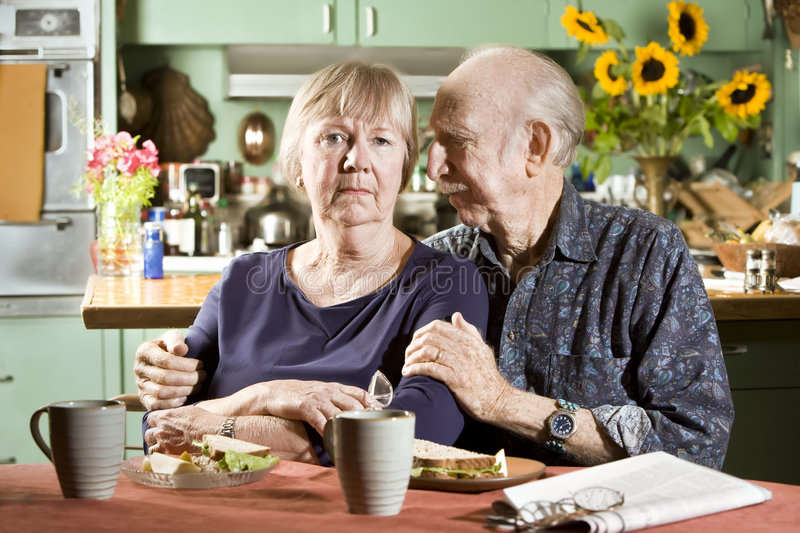 Portrait of Worried Senior Couple. In their Dining Room royalty free stock photography