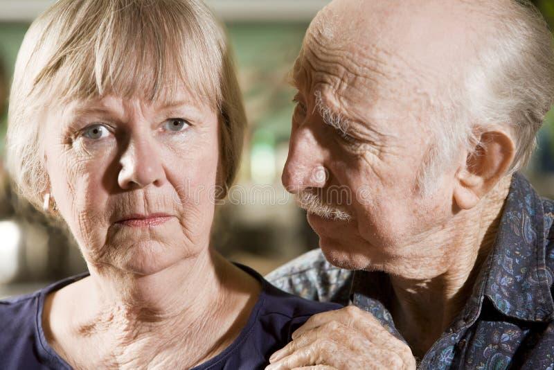 Portrait of Worried Senior Couple. Close Up Portrait of Worried Senior Couple royalty free stock photos