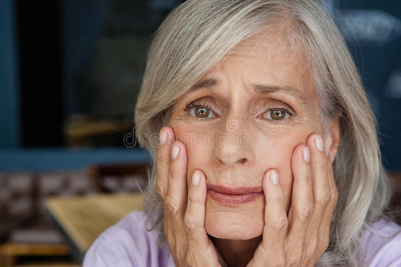 Portrait of worried senior woman royalty free stock photography