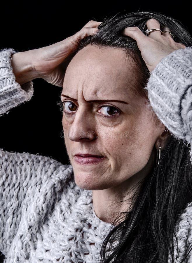 Portrait of worried woman stock image
