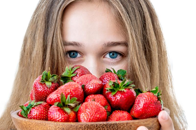 Portrait of yaung woman eating strawberries. Healthy happy smiling woman eating strawberry. stock photography