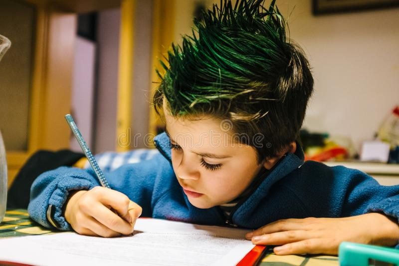 portrait of 9 year old boy at home with green colored hair crest royalty free stock images