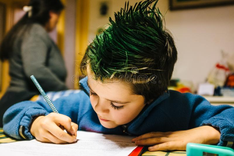 portrait of 9 year old boy at home with green colored hair crest royalty free stock photos
