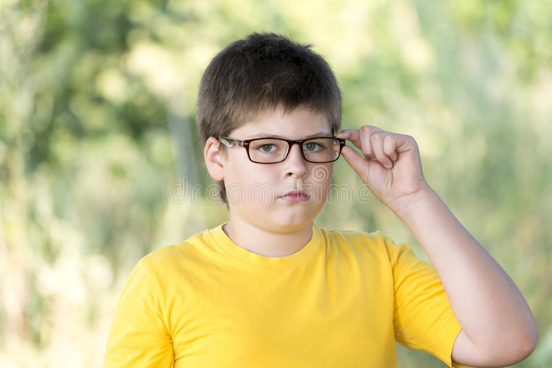 Portrait of 10-year-old boy in park royalty free stock photography