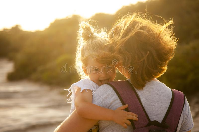 Portrait of a 3 year old Caucasian girl with blond hair who shows her tongue playfully stock photography