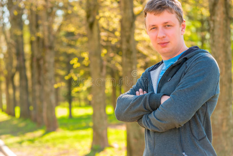 Portrait of a 30 year old trainer in a sports suit. Outdoors stock photos