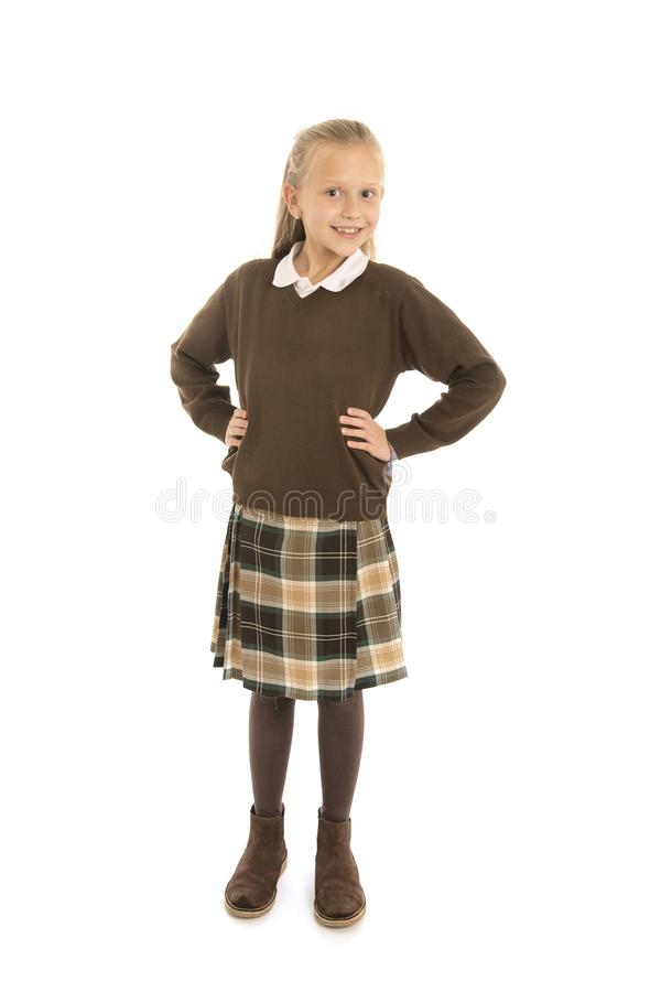 Portrait of 7 or 8 years old beautiful and happy schoolgirl female child in school uniform smiling cheerful isolated on white back royalty free stock photos