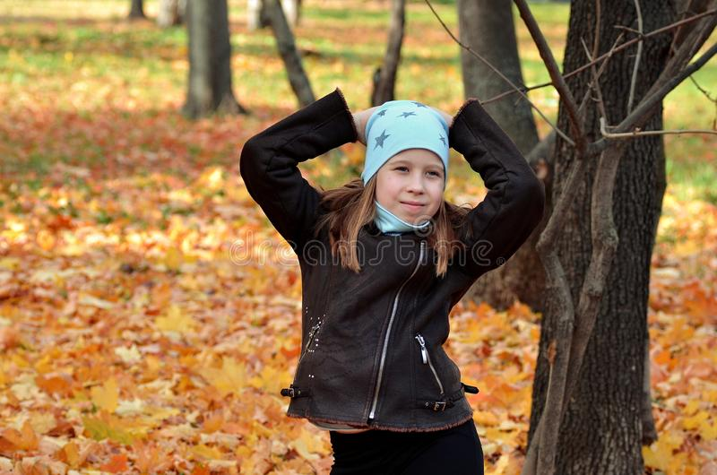 Portrait of a yong girl in the autumn season stock images