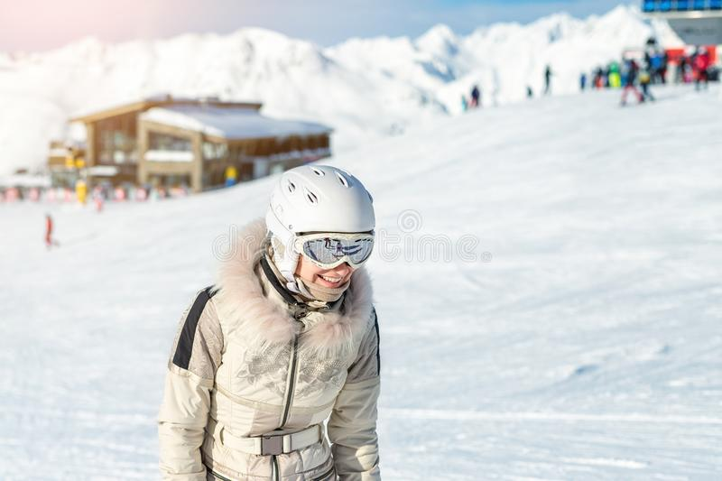 Portrait of young adult beautiful happy caucasian woman smiling near lift station at alpine winter skiing resort. Girl in fashion stock photos