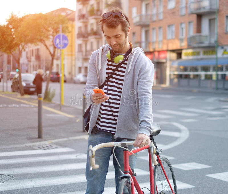 Portrait of young adult man crossing road royalty free stock image