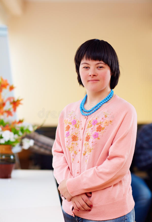 Portrait of young adult woman with down`s syndrome stock images