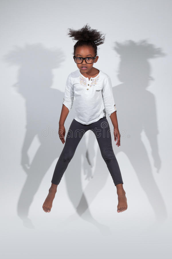 Download Portrait Of Young African American Girl Jumping Stock Image - Image: 27465395