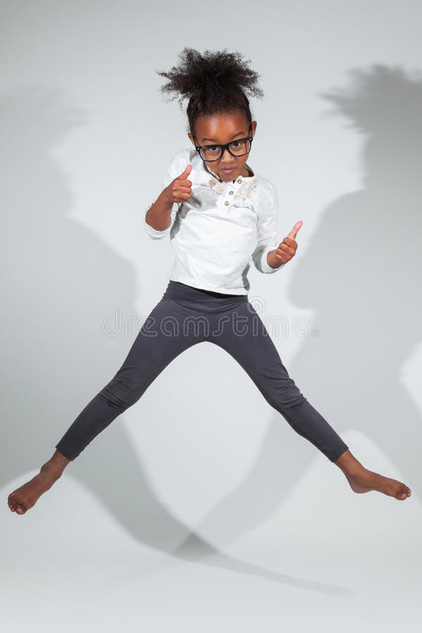 Download Portrait Of Young African American Girl Jumping Stock Photo - Image: 27465414