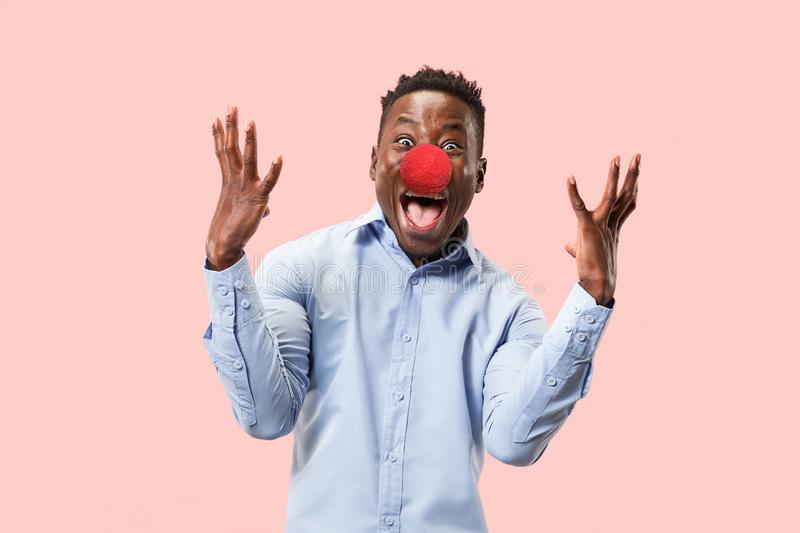 Portrait of young african-american man looks crazy happy. Red nose day celebrating. Portrait of young happy man celebrating red nose day. African male model royalty free stock image