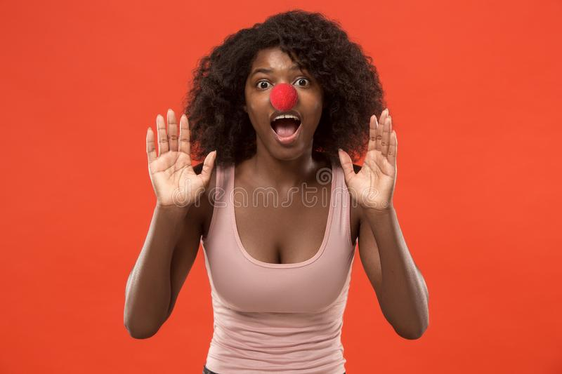 Portrait of young african-american woman celebrating red nose day stock photo