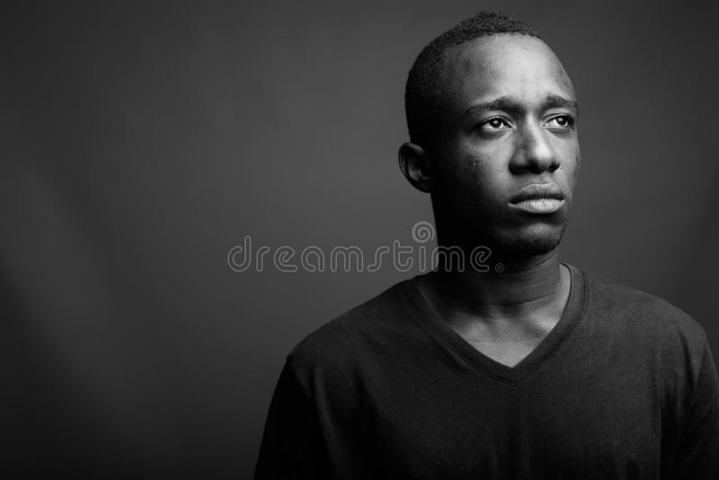 Portrait of young African man in black and white stock image