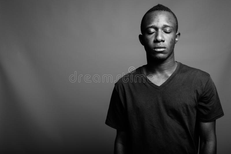 Portrait of young African man in black and white royalty free stock image