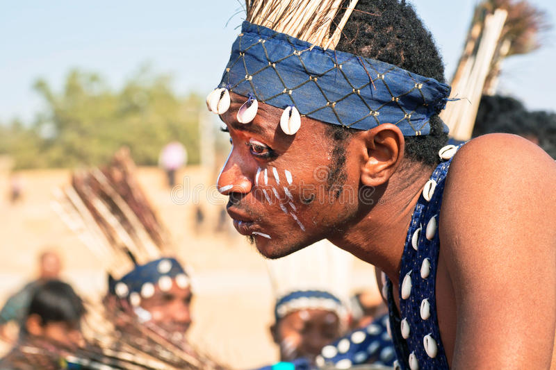 Portrait of young african man with painted face in tribal tradition stock image