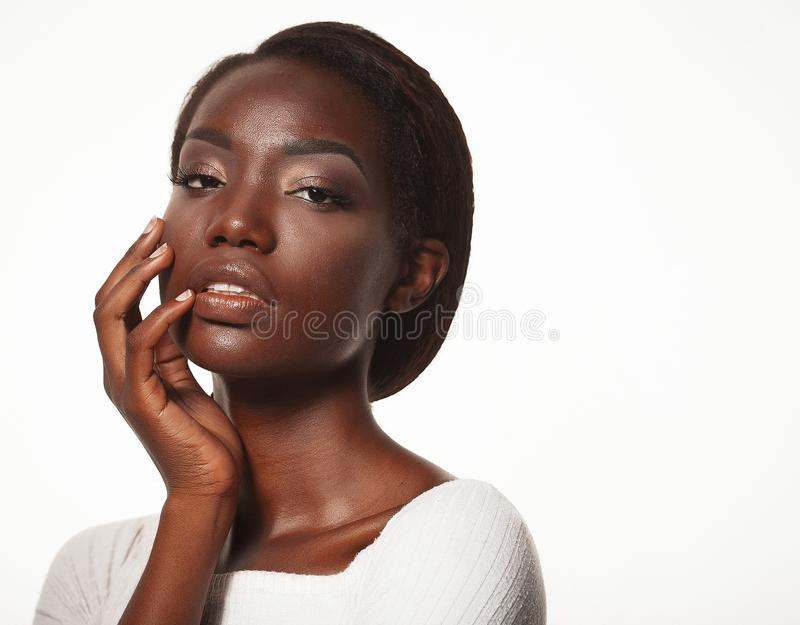 Portrait of Young African model with a beautiful makeup in studio royalty free stock image