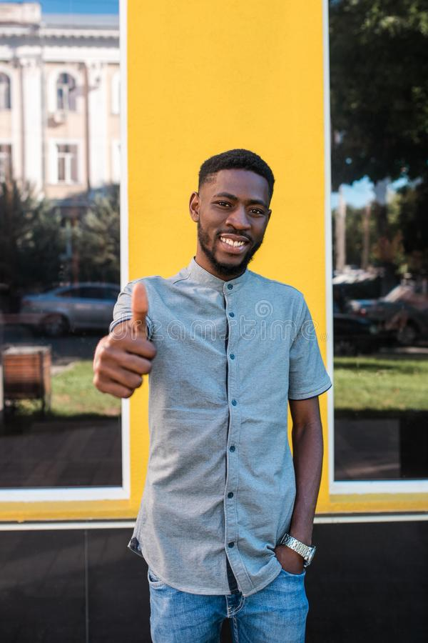 Portrait of young afro american man in the street. royalty free stock images
