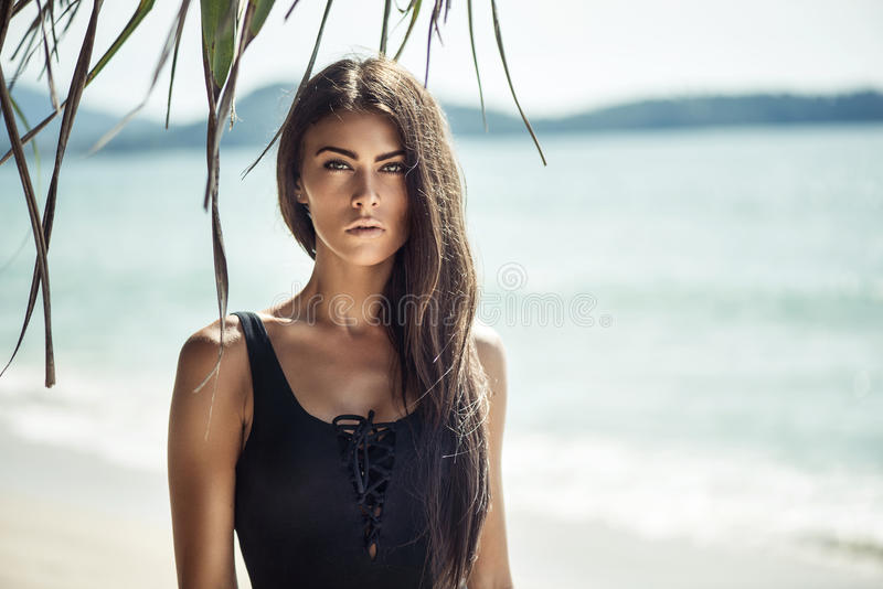 Portrait of a young, alluring woman on a beach stock images
