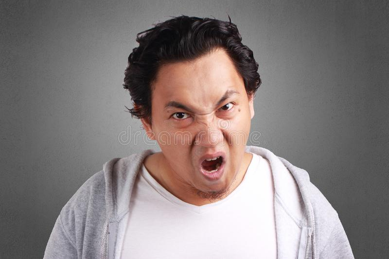 Portrait Of Young Angry Man stock photography