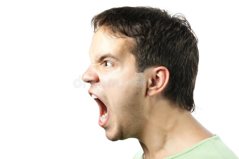 Portrait of young angry man sreaming isolated stock photo