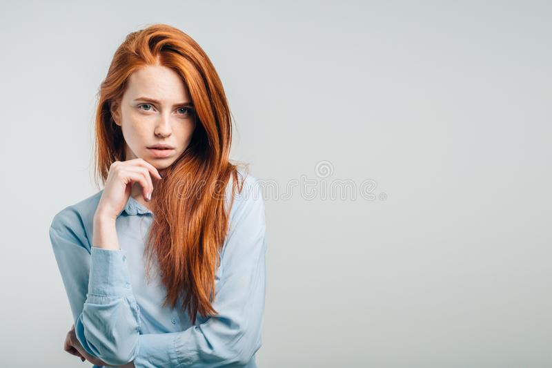 Female with freckles and pursed lips having disappointed unhappy look. Portrait of young annoyed female with freckles and pursed lips having disappointed unhappy stock image