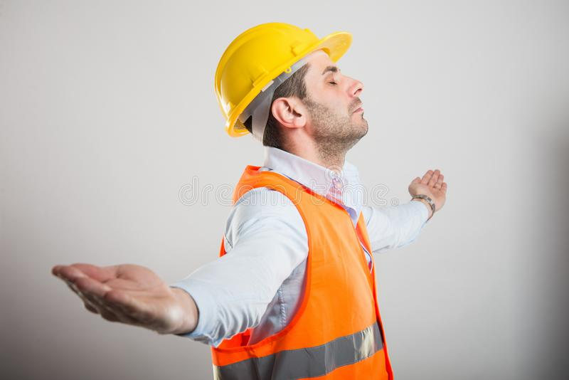 Portrait of young architect with arms spread like winning royalty free stock images